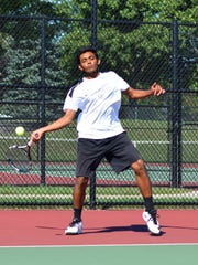 Plymouth's Yogesh Mohanraj keeps the play moving at No. 1 doubles.