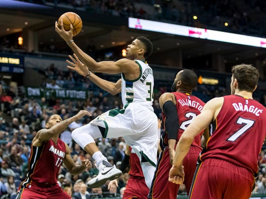 Feb 8, 2017; Milwaukee, WI, USA; Milwaukee Bucks forward Giannis Antetokounmpo (34) shoots during the third quarter against the Miami Heat at BMO Harris Bradley Center.