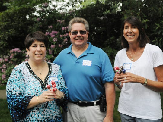 Marianne and Mike Rossi, left, and Sandi Firtion attended the Annual Lollipop Party, a Nutley Volunteer Emergency and Rescue Squad fundraiser, on Saturday, June 4, 2016.