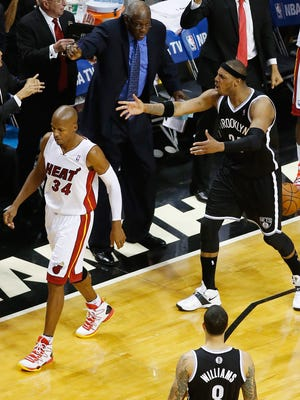 Heat guard Ray Allen walks past complaining ex-teammate Paul Pierce of the Nets during Game 5 Wednesday.