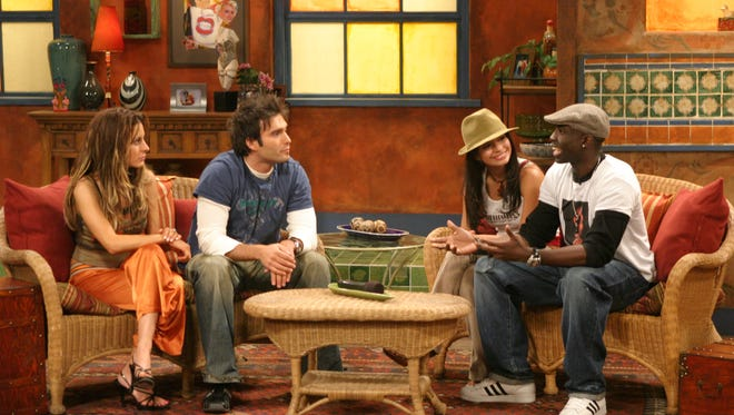 Sam Sarpong (far right) on the set of 'The Rub' with Kerri Kasem (l-r), Diego Vargas, Kristina Guerrero, in 2004.