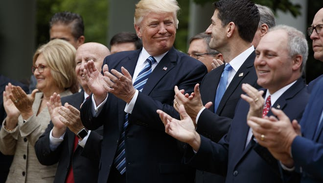 Evan Vucci, AP President Trump and House Speaker Paul Ryan celebrate passage of the health care bill. The House of Representatives voted 217-213, demonstrating  divisions that remain on the legislation. President Donald Trump smiles at Rep. Paul Ryan, R-Wis., after the House pushed through a health care bill, in the Rose Garden of the White House, Thursday, May 4, 2017, in Washington. (AP Photo/Evan Vucci) ORG XMIT: DCEV205