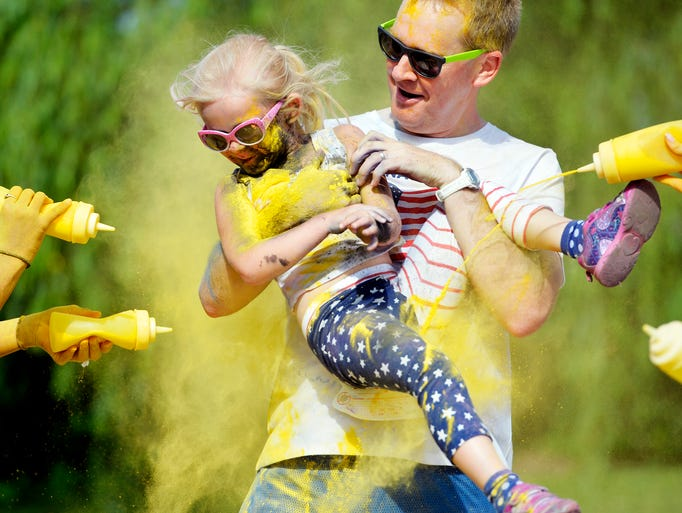 Aaron Dalton of Manchester Township carries his daughter