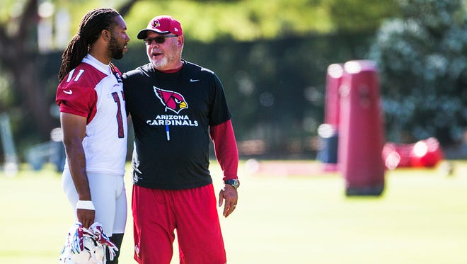 Cardinals' Larry Fitzgerald, left, and coach Bruce Arians talk at practice at the Tempe facility Tuesday morning, May 26, 2015.