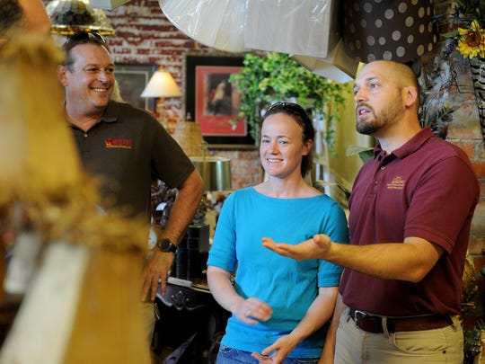 Walter Lambert, right, talks to visitors  in Hello Again located downtown Wichita Falls before the start of Small Business Crawl Thursday, Oct. 5, 2017. The crawl took groups on a tour of 34 businesses that make up the Depot District located along Ohio Avenue and Sixth and Ninth streets. Hello Again was the first stop of the night.