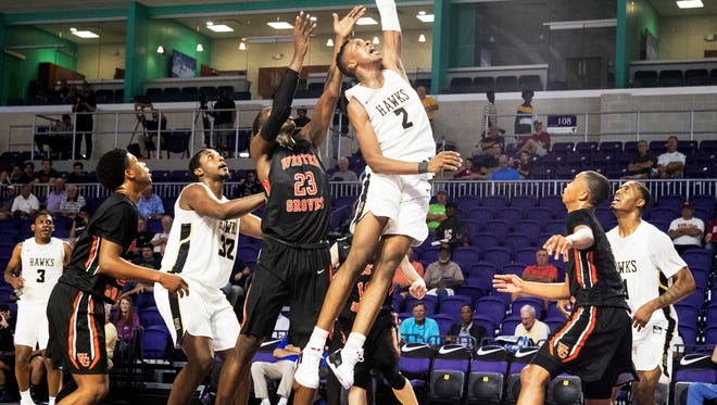 Hudson Catholic's Louis King goes to the basket against Webster Groves Carte'Are Gordon during the opening game of the Culligan City of Palms Classic at Suncoast Credit Union on Monday. King had 30 points in Hudson's win. Final score was 84-52.