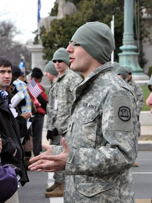 Spc. Nicholas Schaa from the 1133rd Transportation Company provides some last-minute instructions to inauguration visitors just prior to being admitted to the security station near the Pennsylvania Avenue parade route. Members of the Iowa National Guard assisted with the 57th presidential inauguration in Washington D.C. in 2013.