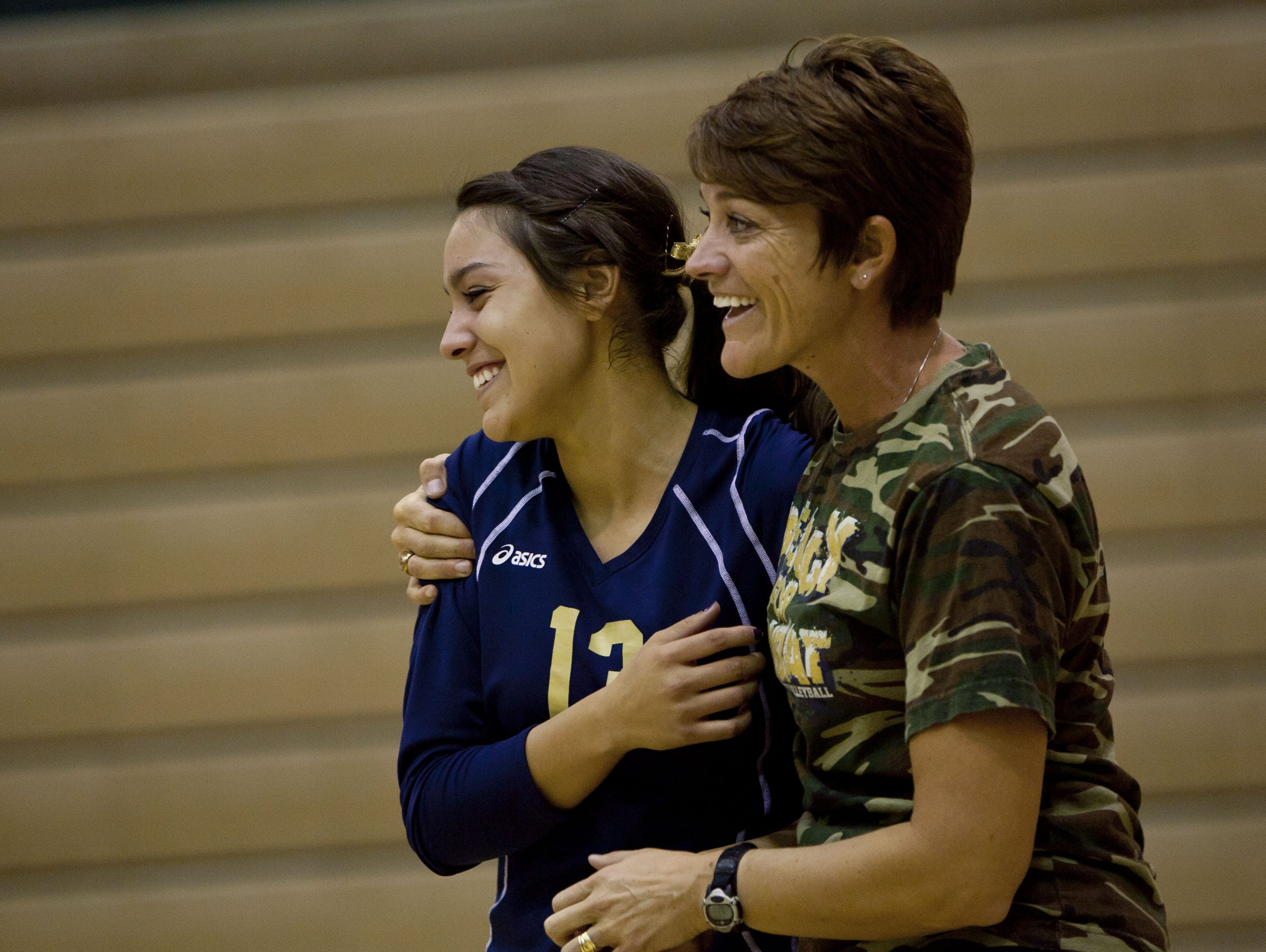Snow Canyon volleyball senior and coach Ciara and Alaina Parker walk onto the court during senior night for the Warriors' final Region 9 match Thursday, Oct. 20, 2011.