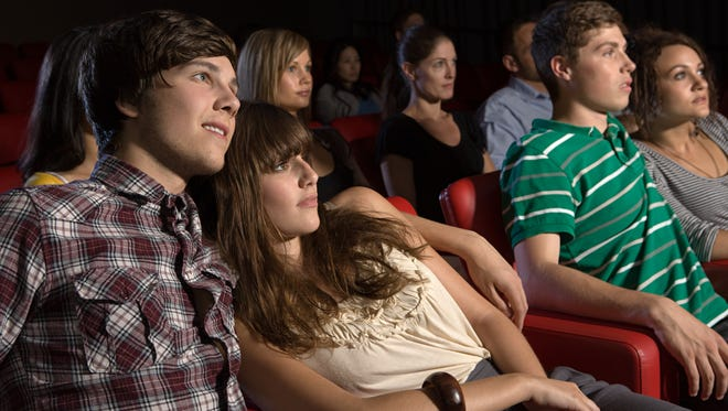 Young couples watching a movie.