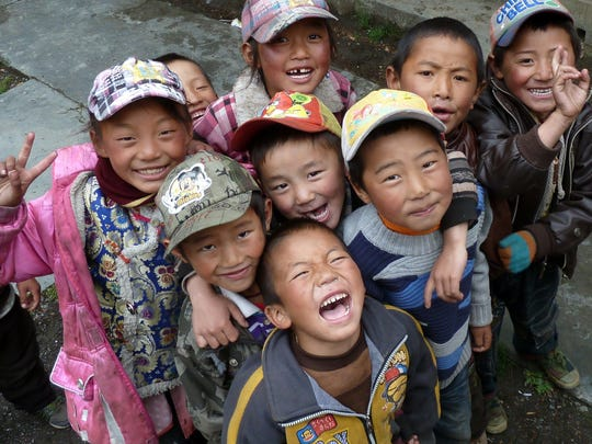 School children are pictured in Sihurong Village in Tibet, where the medical clinic was outfitted with solar panels in 2012.