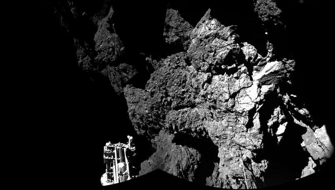 A combination of photographs taken with the CIVA camera system on the Philae lander shows the surface of Comet 67P/Churyumov-Gerasimenko on Nov. 13. One of the lander's three landing feet is in the foreground.