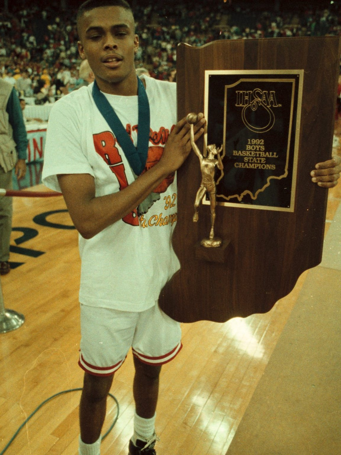 Billy Wright, shown with the Indiana High School Athletic Association (ISHAA) basketball trophy in 1992.