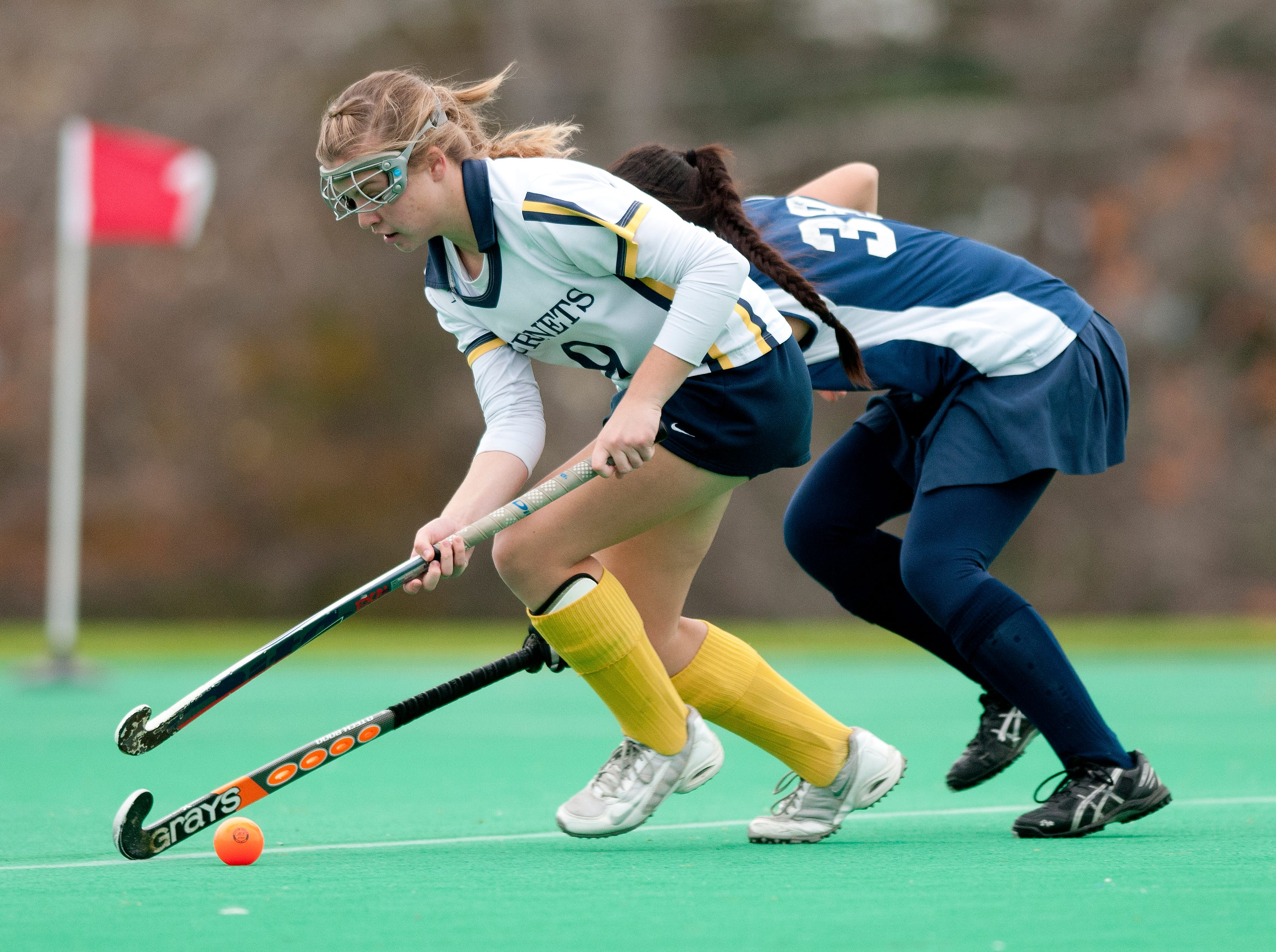 Essex's Kathleen Young, left, runs past Hartford's Jenna Yee with the ball during the Division I field hockey state championship between Hartford and Essex at Moulton/Winder field last season.