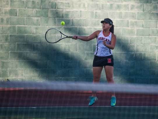 Northeastern's Evonne Qiu competes against Spring Grove's