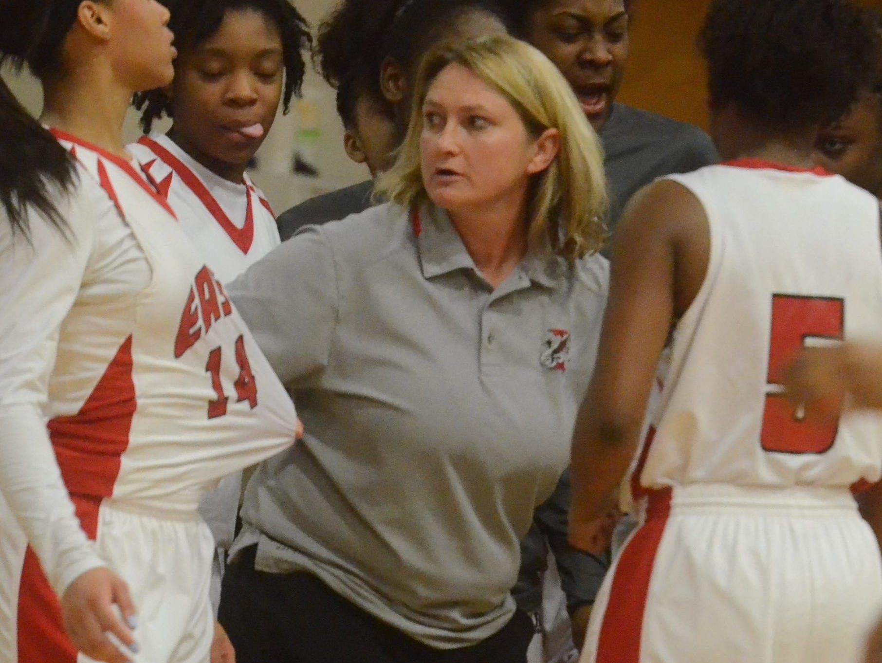 East Nashville coach Lois Donaldson instructs her team in a timeout during Tuesday's District 10-AA championship.