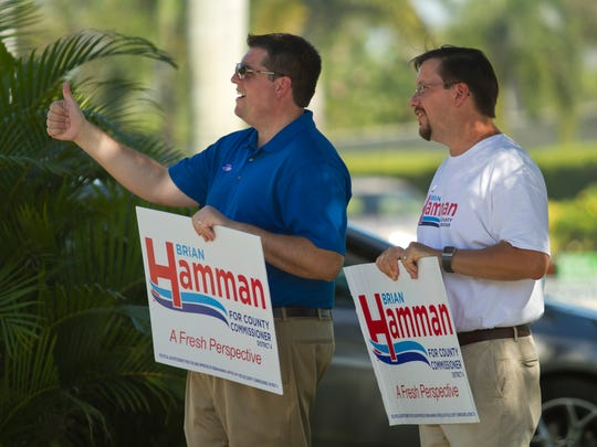 Brian Hamman and his campaign manager Terry Miller campaign by St. Hillary's Catholic Church. The trend of more people voting by mail continued Tuesday.