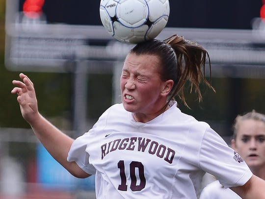 Kaitlin Devir of Ridgewood heads the ball during the