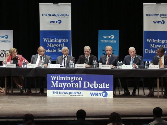 Wilmington mayoral candidates (from left) Maria Cabrera, Theo Gregory, Norm Griffiths, Kevin Kelley, Bob Marshall, Mike Purzycki and Eugene Young take part in a debate at the Grand Opera House on May 26. A forum Thursday is focusing on arts and culture.