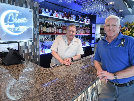 Blue Moon Restaurant and Bar Owners Tim Ragan and Randy Haney at the bar on Baltimore Avenue in Rehoboth Beach.
