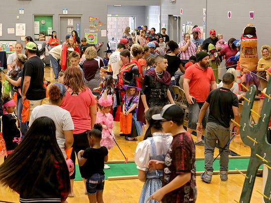 Over a hundred children play a variety of carnival games and particpate in a costume contest at the city of Wichita Falls' Halloween in the Park Saturday afternoon at the Scotland Park Elementary School gymnasium.