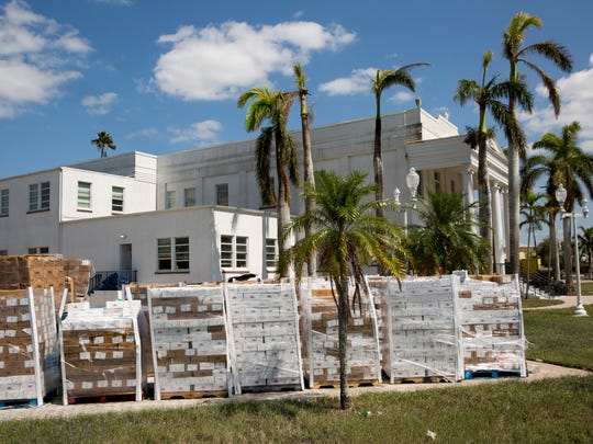 Pallets of ready-to-eat meals sit stacked outside Everglades City Hall on Monday, Sept. 18, 2017, in Everglades City, Fla.