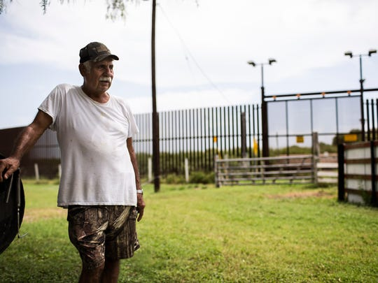 Juan Cavazos at his home on Oklahoma Avenue in Brownsville. The retired teacher accepted $21,500 for the two acres the government seized, but later discovered that neighbors who hired lawyers got paid much more for their land.