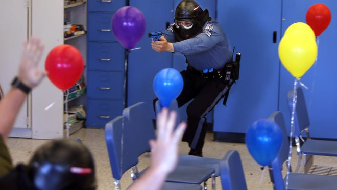 Bloomingdale Sgt. Dave Terpstra engages 'bad guys' in a classroom during an active shooter training for Riverdale and Bloomingdale police at Riverdale School. Colored balloons are placed to represent students. April 15, 2016. Riverdale, N.J.