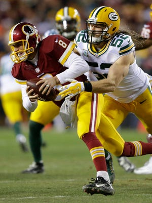 Packers linebacker Clay Matthews sacks Washington quarterback Kirk Cousins in the first quarter of an NFC playoff game in January.