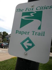 A sign on Oak Street in Neenah marks the Fox Cities Paper Trail.