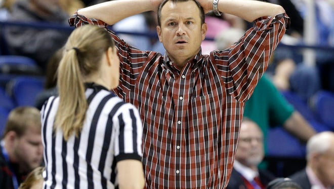 Louisville head coach Jeff Walz reacts to a call during the second half of an NCAA college basketball game against Syracuse  in the Atlantic Coast Conference tournament in Greensboro, N.C., Saturday, March 5, 2016. Syracuse won 80-75.