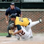Hartland second baseman Hunter Delanoy makes a diving catch on this liner in the fifth, them tags the runner atsecond to complete the double play and kill a Portage Northern rally.
