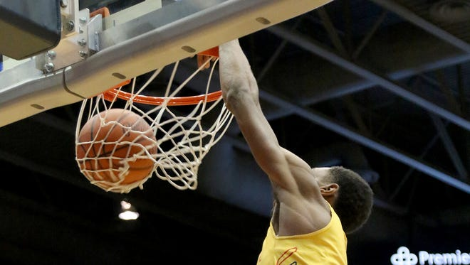 Purcell Marian's A.j. Garrett dunks the ball  during the Cavaliers district game against Anna, Tuesday, March, 6, 2018.