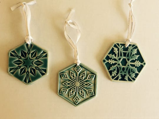 The winner of our haiku contest will get these Pewabic snowflakes.