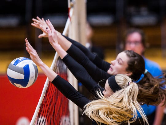 Anderson University senior Rachel Burts blocks the ball during the AU volleyball game against Brevard on Saturday, October 29, 2016 in Anderson.