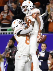 Texas running back Daniel Young, right, celebrates