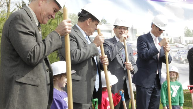 From left, Tom Murtaugh, Tony Roswarski, Terry Wilson and John Dennis stand with children from the YMCA preschool program at a groundbreaking for a   facility, which will include a new YMCA among other amenities, on April 4, 2017, in Lafayette.