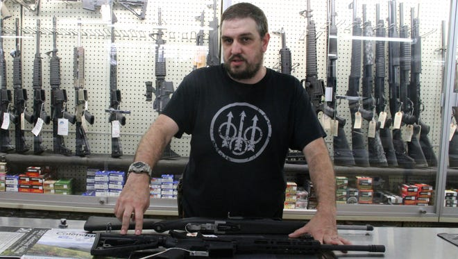 Western True Value employee Josh Prather displays an AR-15 rifle. Western and United Way of Otero County resumed their firearms raffle Wednesday.