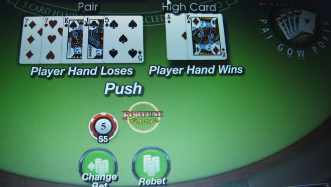 In this Jan. 31, 2014 photo, a computer screen in Atlantic City, N.J., shows a game of Pai Gow underway on a gambling website.