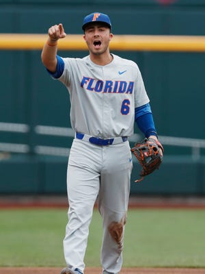 Florida Gators third baseman Jonathan India (6) gestures during the game against the Texas Longhorns at the College World Series at TD Ameritrade Park.