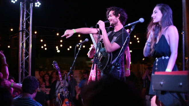 Little Red Spiders, a five-piece group with two backing female vocalists, performs at the Palm Springs showcase on Wednesday.