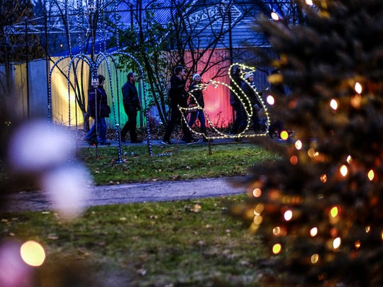 Families stroll through the Wonderland of Lights at