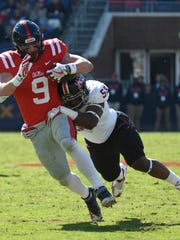 UL linebacker Justin Middleton brings down Ole Miss tight end Dawson Knox last season. Middleton is the Ragin' Cajuns' third-leading tackler this year.