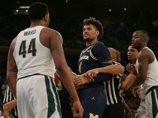 Michigan State forward Nick Ward (44) and Michigan forward Isaiah Livers (4) will square off twice during the Big Ten season in a span of 13 days.