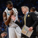 Georgia Tech head coach Brian Gregory directs Georgia Tech center Demarco Cox (4) during the second half of an NCAA college basketball game against North Carolina, Tuesday, March 3, 2015, in Atlanta. North Carolina won 81-49. (AP Photo/Jon Barash)