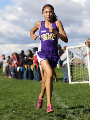 LaKyla Yazzie of Kirtland Central runs ahead of the competition on Oct. 23 at the Kirtland Ridge Run in Kirtland.