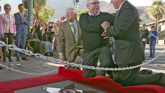 Tim Hanlon, center, is congratulated by Palm Springs Mayor Steve Pougnet, right, and Walk of Stars President Robert Alexander, left, during Monday's unveiling.