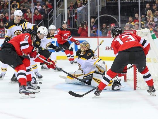 Boston Bruins goalie Anton Khudobin (35) defends his