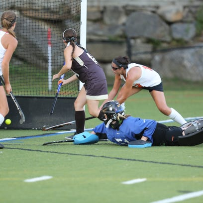 Mamaroneck's Paige Danehy (17) scores during girls