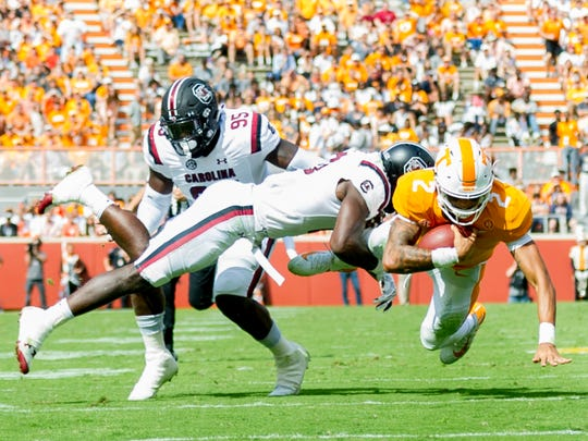 Tennessee quarterback Jarrett Guarantano (2) is tackled by South Carolina linebacker Skai Moore (10) during the Tennessee Volunteers vs South Carolina Gamecocks game at Neyland Stadium in Knoxville, Tennessee on Saturday, October 14, 2017.