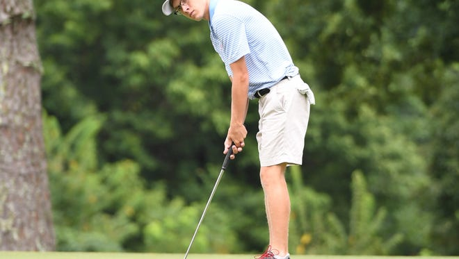 University School of Jackson's Grayson Kirk looks to putt during the Fellowship of Christian Athletes boys and girls golf tournament, Monday, August 7.